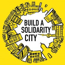 Stadtsilouette in einem Kreis. Schrift: Build a Solidarity City
